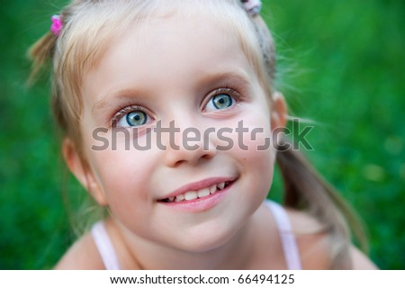 Close-up portrait of a pretty  liitle girl - stock photo