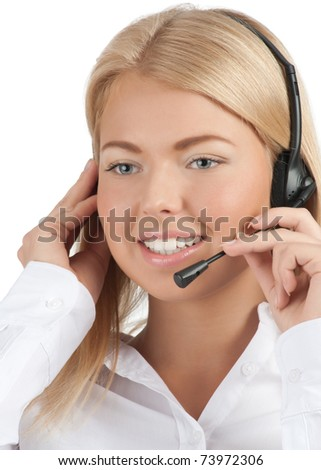 Close-up portrait of a pretty young female call center employee wearing a headset with, against white background - stock photo