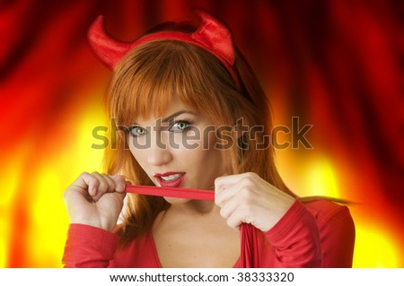 close up portrait of a red haired girl with horns like a devil looking in camera