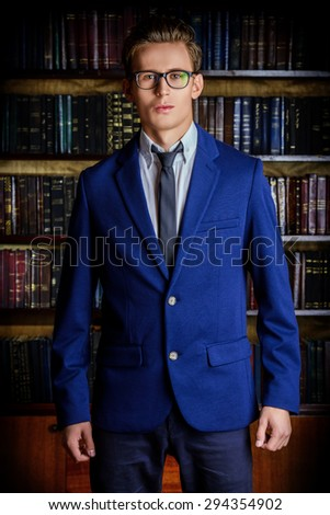 Close-up portrait of a respectable handsome man in his cabinet, library. Classic vintage style. - stock photo