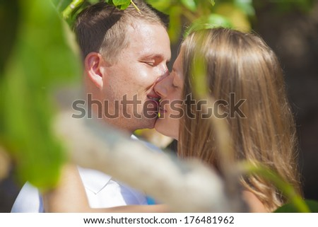 Close up portrait of a romantic young couple - stock photo