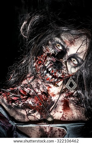 Close-up portrait of a scary bloody zombie girl. Horror. Halloween.  - stock photo