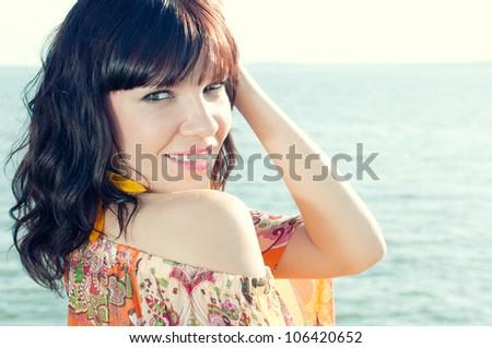 Close-up portrait of a sensual young woman enjoying summer evening - stock photo