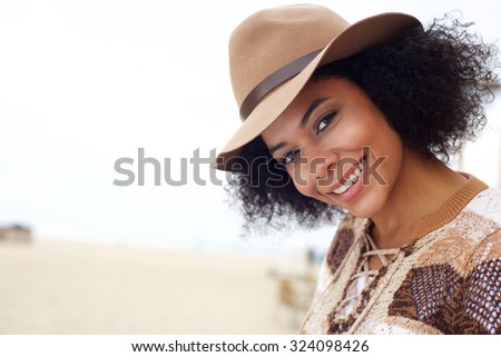 Close up portrait of a smiling african american fashion woman with hat - stock photo