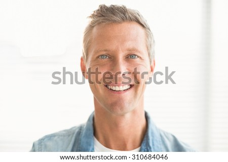 Close up portrait of a smiling businessman at the office
