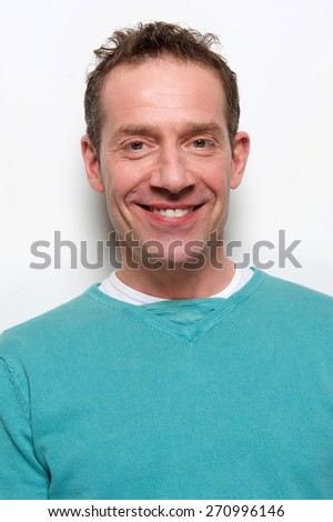 Close up portrait of a smiling middle aged man on white background  - stock photo
