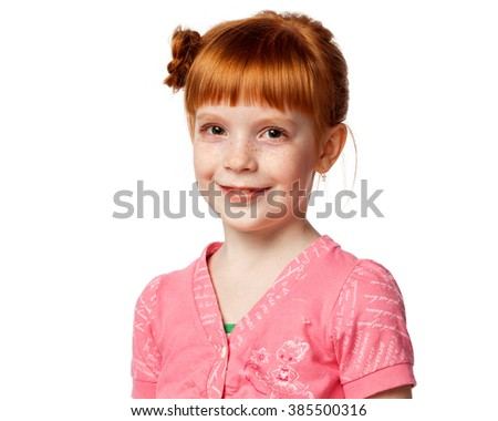 Close up portrait of a smiling red-haired girl in a pink shirt isolated on white background - stock photo