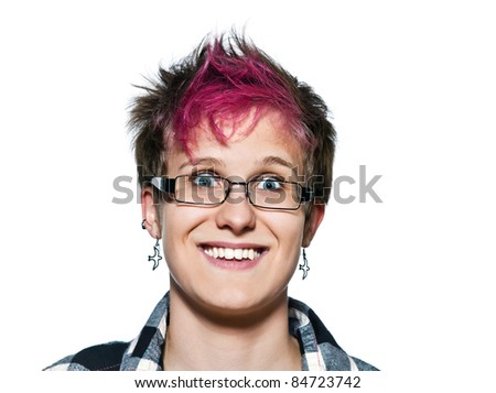 Close-up portrait of a smiling young woman with eyes wide open in studio on white isolated background - stock photo