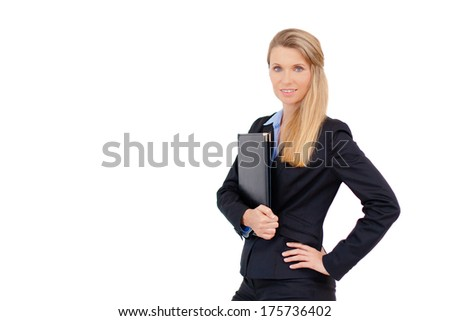 Close-up portrait of a successful business woman standing and holding a folder, isolated against white. Copy space.