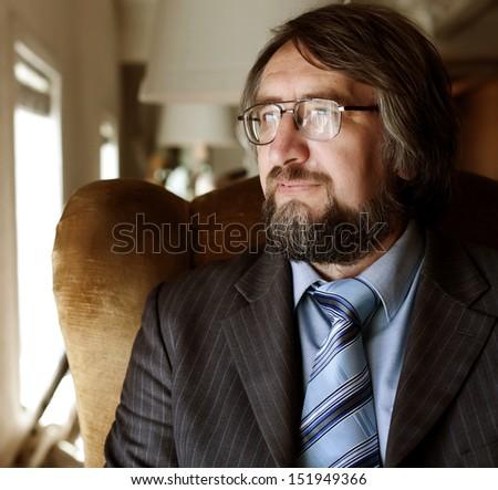 Close up portrait of a successful senior business man  - stock photo