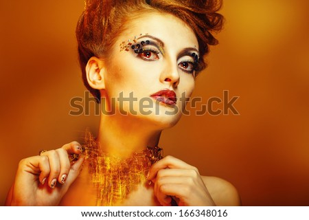 Close-up portrait of a young and attractive girl with hairstyle and jewelry, nail art design - stock photo
