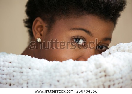 Close up portrait of a young black woman covering face  - stock photo