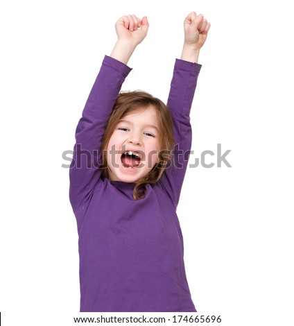 Close up portrait of a young girl cheering with raised arms on isolated white background - stock photo