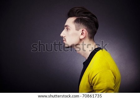 Close-up portrait of a young handsome man - stock photo