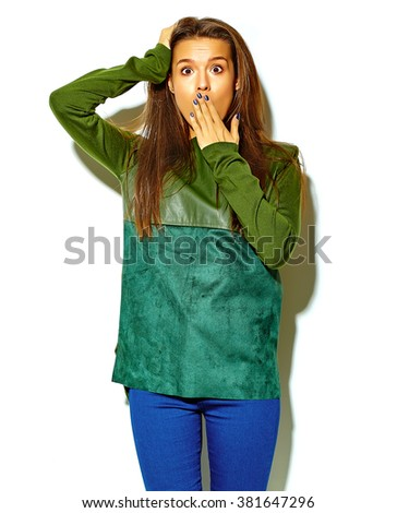 Close-up portrait of a young hipster woman scared ,afraid and and touching her head, looking at camera isolated on white  - stock photo