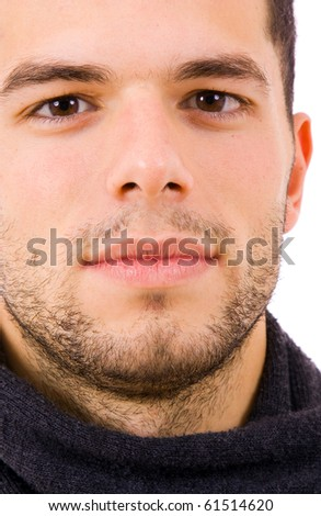 Close up portrait of a young man dressed with winter clothes, isolated on white