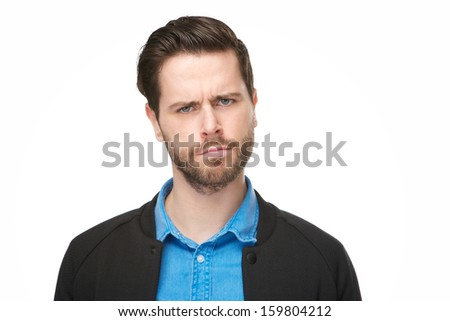 Close up portrait of a young man with a confused, thinking face - stock photo