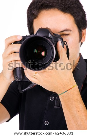 Close up portrait of a young photographer with camera at the studio - stock photo