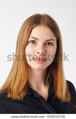 Close up portrait of a young pretty woman. - stock photo