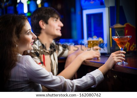 close-up portrait of a young woman in a bar