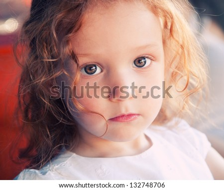 Close up portrait of adorable 3 years old girl - stock photo