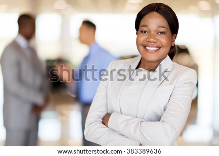 close up portrait of african america businesswoman at car dealership - stock photo