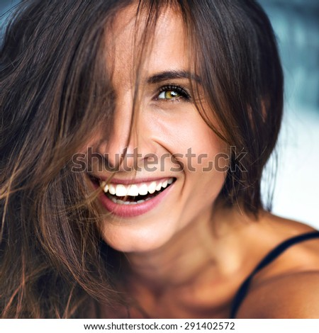 Close up portrait of amazing smiling burn woman, long healthy fluffy hairs, natural make up, perfect skin, positive emotions, happiness , joy, soft vintage colors.