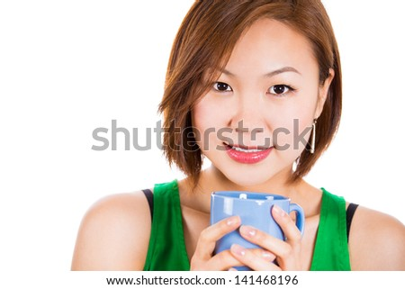 Close-up portrait of an adorable happy woman drinking her tea.