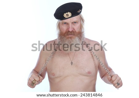 close-up portrait of an adult male with a beard and mustache with a naked torso and a chain in hand on white background studio - stock photo
