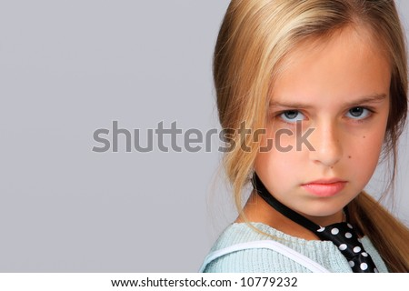 Close-up portrait of an angry teenager with temperament . - stock photo