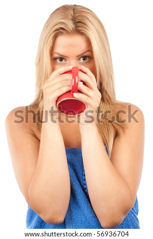 Close up portrait of an attractive blonde lady drinking coffee or tea - stock photo