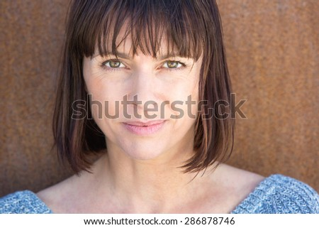 Close up portrait of an attractive older woman - stock photo