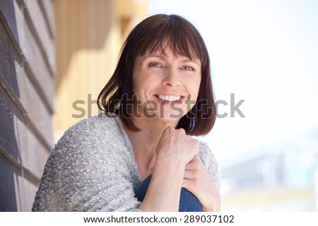 Close up portrait of an attractive older woman smiling - stock photo