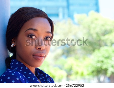 Close up portrait of an attractive young african american woman looking - stock photo