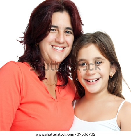Close up portrait of an hispanic mother and her beautiful small daughter isolated on white