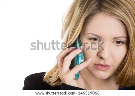 Close-up portrait of an upset, sad, depressed and worried blonde woman talking on the phone, isolated on a white background  - stock photo