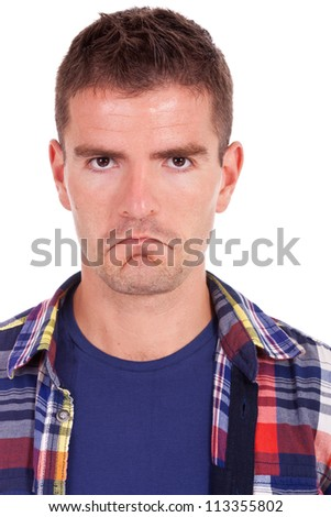 close up portrait of an upset young man looking at camera white background