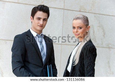 Close up portrait of attractive business partners looking at camera. - stock photo