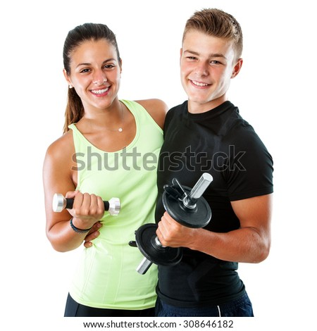 Close up portrait of attractive healthy teen gym couple with dumbbells.Isolated on white background. - stock photo