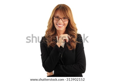 Close-up portrait of attractive middle age businesswoman standing against white background while looking at camera and smiling.  - stock photo