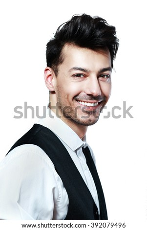 Close-up portrait of attractive smiling young man isolated on white background looking on the camera - stock photo
