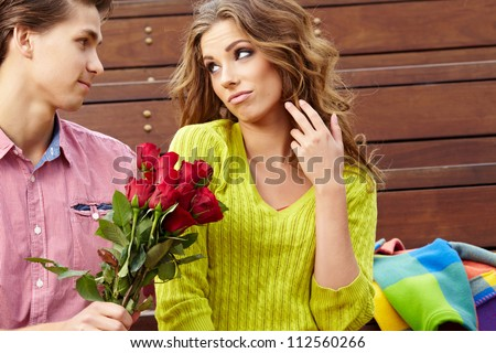Close up portrait of attractive young couple in autumn color. - stock photo