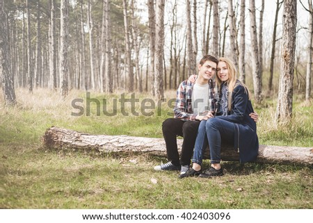 Close up portrait of attractive young  couple in love outdoors - stock photo