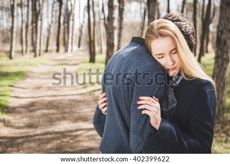 Close up portrait of attractive young couple outdoors - stock photo