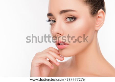 Close up portrait of attrective beautiful woman touching her chin - stock photo