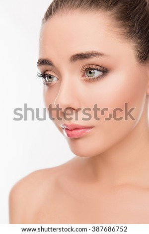 Close up portrait of beatiful smiling woman with sensitive skin - stock photo