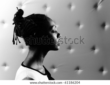 Close-up portrait of Beautiful African woman pose on a beige leather background. - stock photo