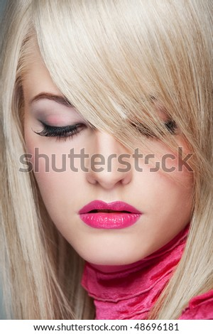 close-up portrait of beautiful blonde looking down - stock photo