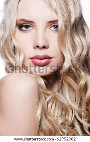 close-up portrait of beautiful blonde with curly hair - stock photo