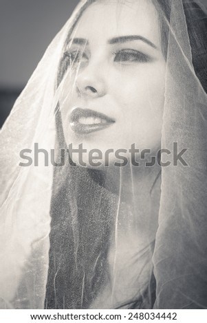 close up portrait of beautiful bride in white - stock photo